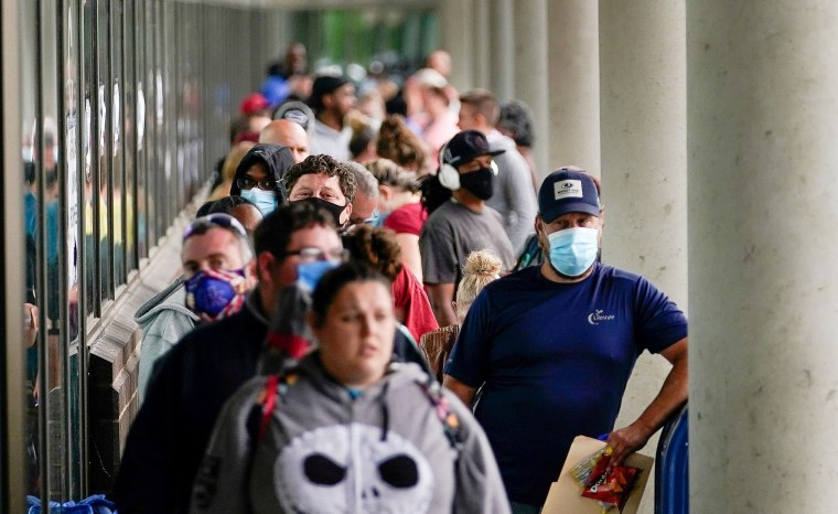 Image: FILE PHOTO: Hundreds of people line up outside a Kentucky Career Center hoping to find assistance with their unemployment claim in Frankfort
