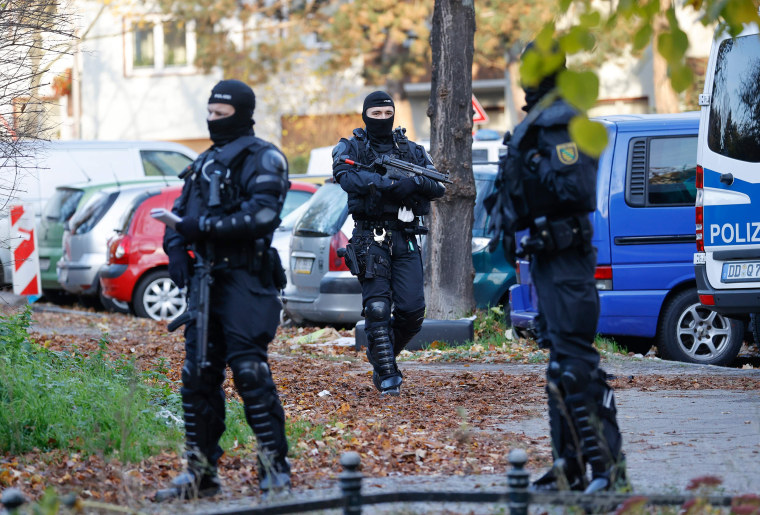 Image: Heavily armed police secure an area in Berlin's Neukoelln district during raids of properties on Nov. 7, 2020 in connection with a spectacular heist on the Green Vault museum in Dresden's Royal Palace