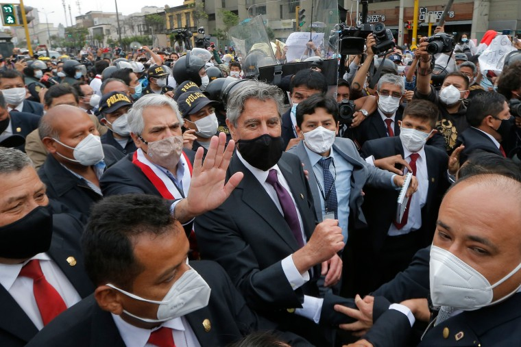 Image: Peru's congressman Francisco Sagasti (C) leaves the Congress after being chosen as Peru's interim President in Lima