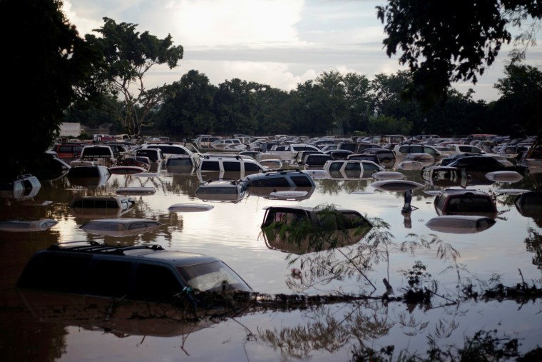 Image: Vehicles are submerged at a plot flooded by the Chamelecon River due to heavy rain caused by Storm Iota, in La Lima