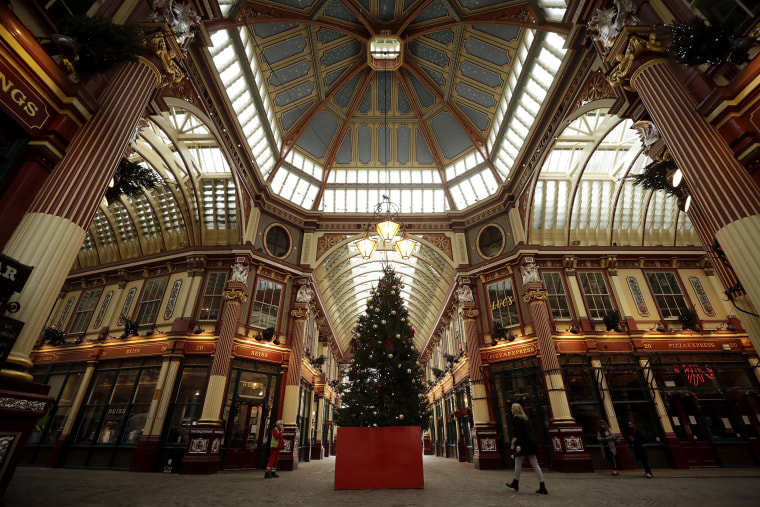 Image: A Christmas tree stands on display in the middle of Leadenhall Market where all the non-essential shops are temporarily closed, during England's second coronavirus lockdown in the City of London financial district of London