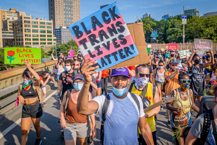 A Black Trans Lives Matter sign held by a participant at the
