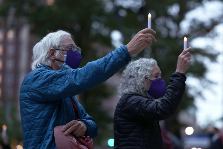 Image: Candlelight Procession Held To Remember Lives Affected By Coronavirus