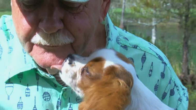 Gunner licks Richard Wilbanks' face after Wilbanks rescued him from a gator's mouth.
