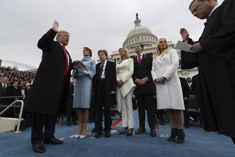Image: Trump takes the oath of office from Chief Justice John Roberts