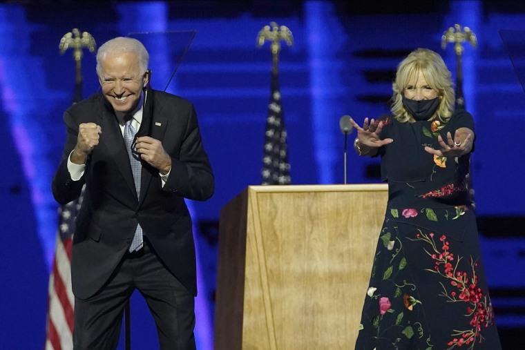 Image: President-elect Joe Biden and wife Jill Biden gesturing to supporter, Saturday, Nov. 7, 2020, in Wilmington, Del.