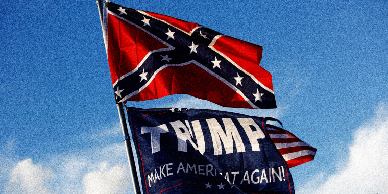 "Image: A Trump \""Make America Great Again!\"" flag flies below a confederate flag"