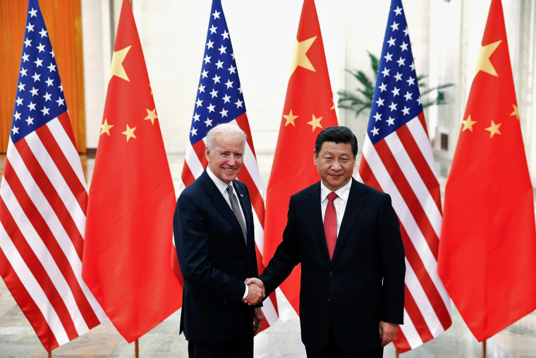 Image: Chinese President Xi Jinping shakes hands with Vice President Joe Biden inside the Great Hall of the People in Beijing