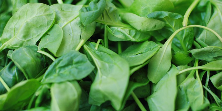 Heap of green spinach leaves