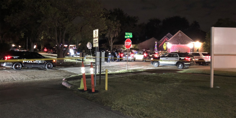 Police cordon off the area around a house where people were being held hostage in Houston on Dec. 3, 2020.
