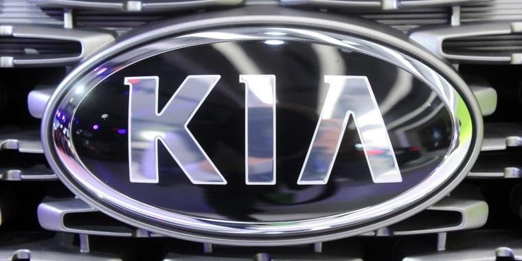 The Kia logo.