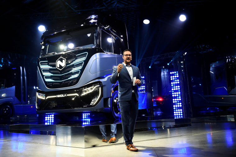 Image: FILE PHOTO: CEO and founder of U.S. Nikola Trevor Milton speaks during presentation of its new full-electric and hydrogen fuel-cell battery trucks in partnership with CNH Industrial, at an event in Turin