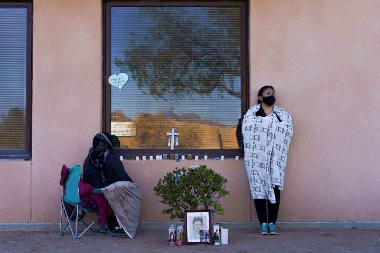 Image: Family of Jose Garcia, 67, who is currently being treated for COVID-19 on a ventilator, wait by his hospital window during a surge of coronavirus disease (COVID-19) cases at Memorial Medical Center in Las Cruces