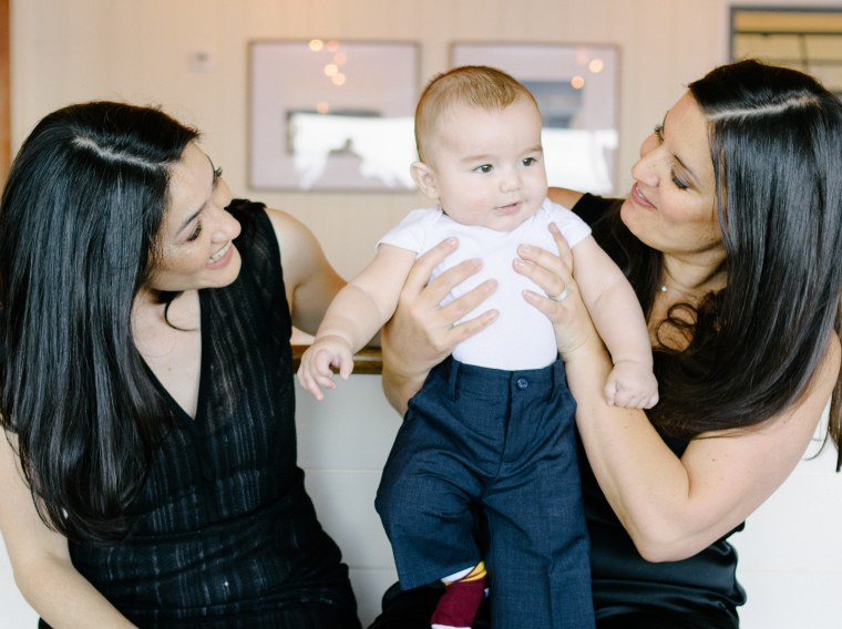 Martina Cheung with her partner, Tracy, and their child.