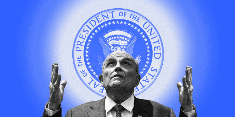 Image: Rudy Giuliani looks up with raised hands at a radiating US Presidential Seal