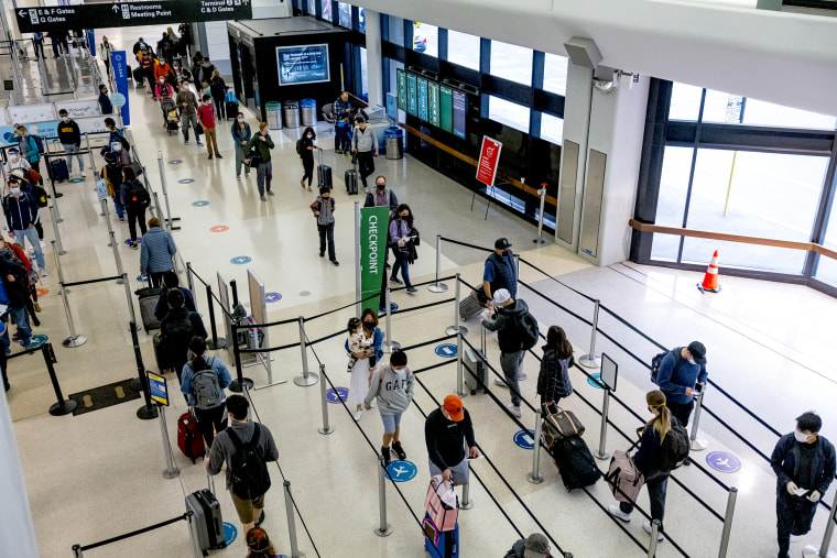 Travelers At SFO Airport As U.S. Holiday Air Travel Surges