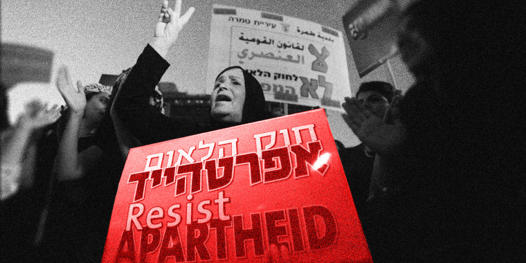 """Image: A woman shouts and holds a protest sign that reads 'resist apartheid' in English and refers to apartheid laws in Hebrew....\"""""""