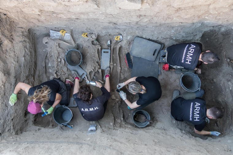 Members of the Association for the Recovery of Historical Memory exhume remains from a site in Segovia, Spain.