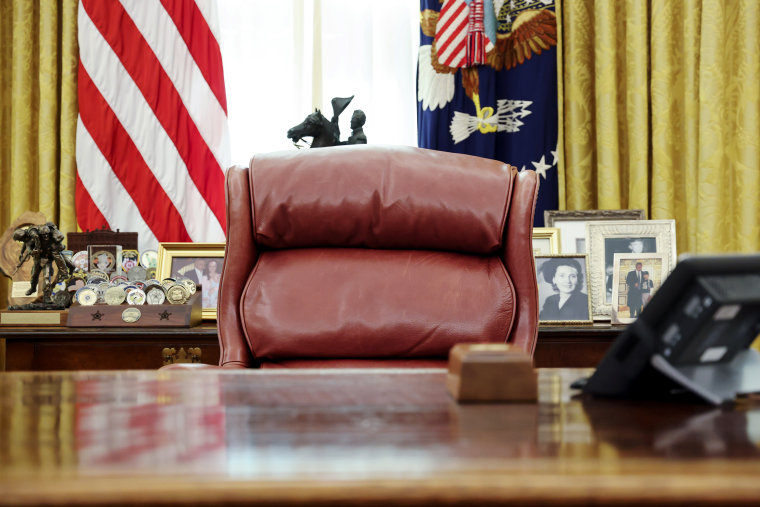 Image: President Trump's chair sits empty in the Oval Office at the White House in Washington
