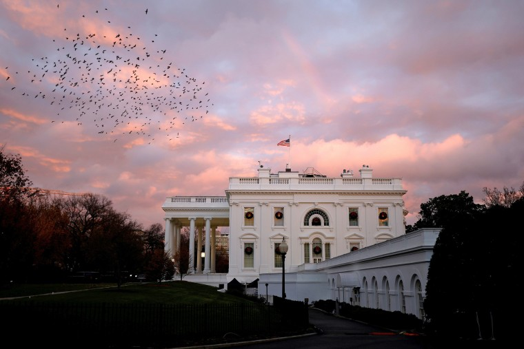 Image: A rainbow appears over the White House as birds fly nearby following a storm in Washington