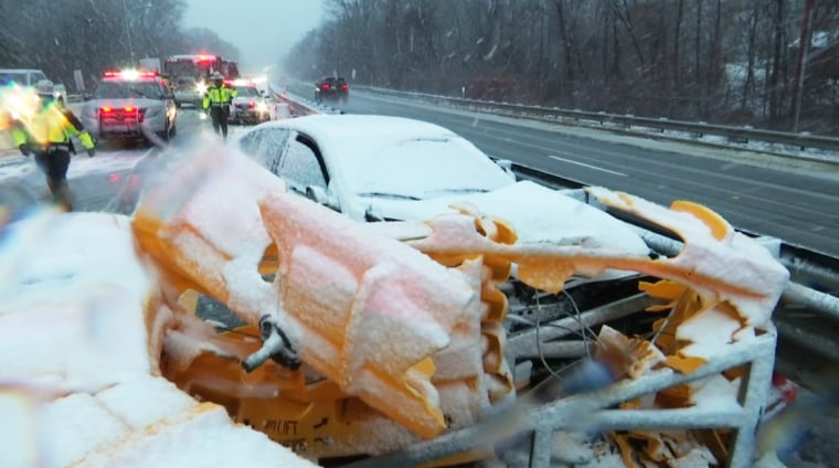 A car crashed into a guardrail during a severe storm in Lincoln, R.I., on Dec. 5, 2020.