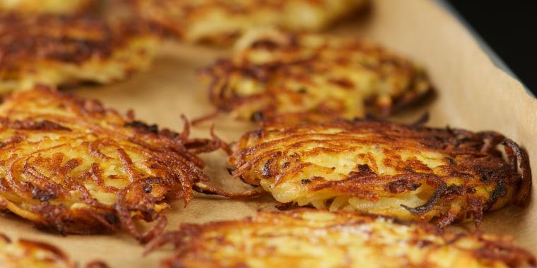 Close-up of crispy potato latkes in a tray