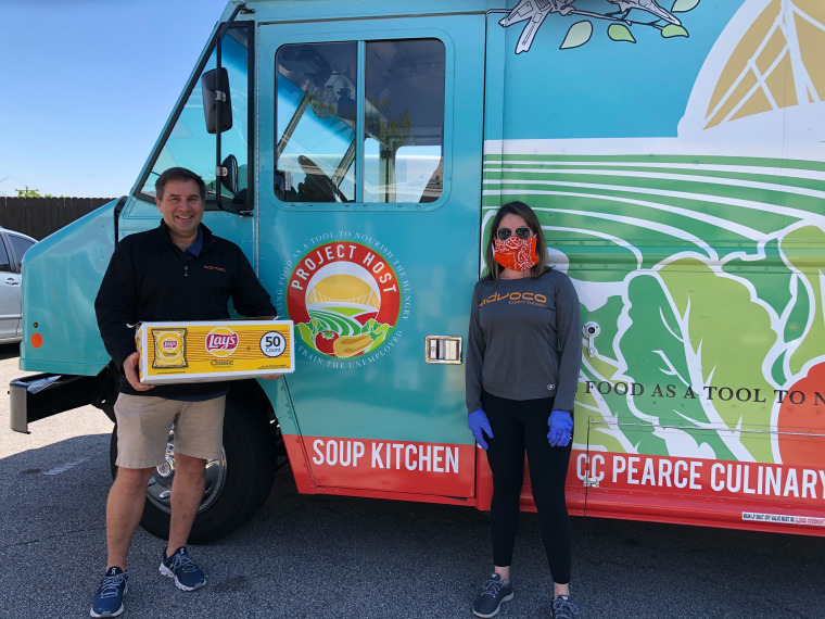 Marty Osborn and Mary Devine, from Advoco, deliver meals and spread smiles to Project Host Soup Kitchen.
