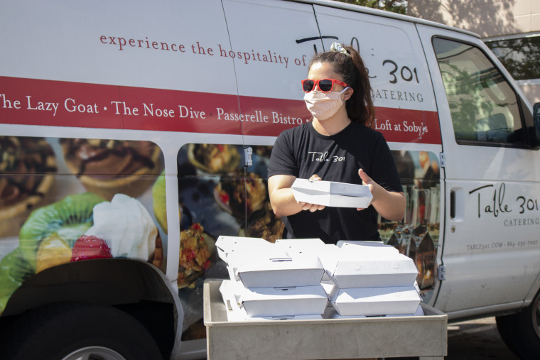 A Table 301 Catering employee delivers meals to Project Host, a soup kitchen in Greenville, South Carolina.