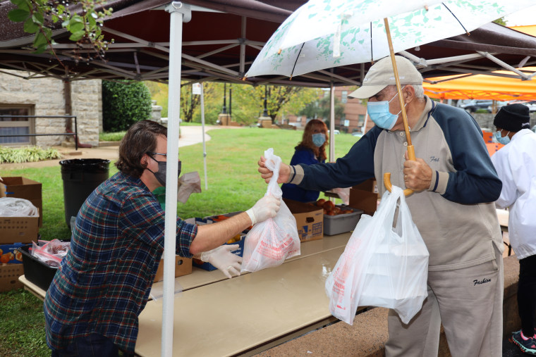 A volunteer hands out meals at Trinity Lutheran church in Greenville, South Carolina.