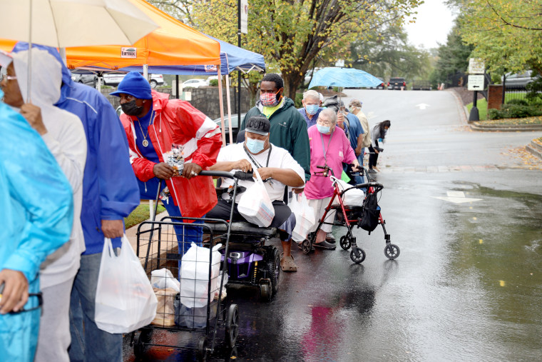 People line up to receive meals at Trinity Lutheran church in Greenville, South Carolina.