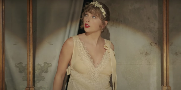 """Taylor Swift wears a lacy ivory dress in the new music video for """"Willow,"""" and it has her fans wondering if it's really a wedding gown."""