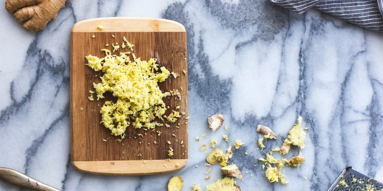 Grated ginger on a chopping board