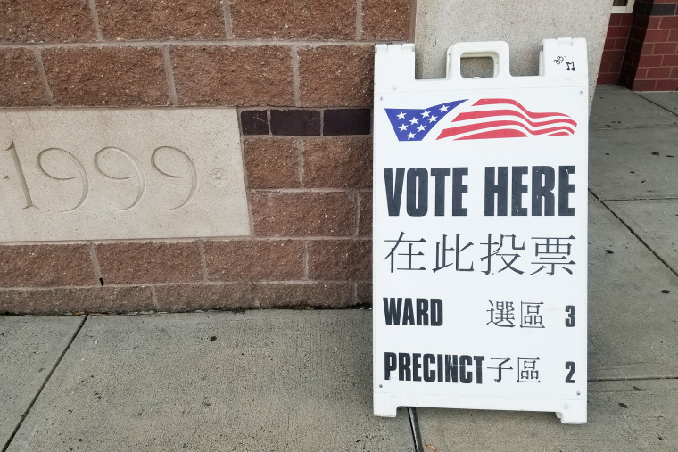 A sign in Chinese and English outside a voting station in Malden, Massachusetts on Election Day, November 3, 2020. Malden qualifies for bilingual voting materials under federal law because of its large Chinese-speaking population.