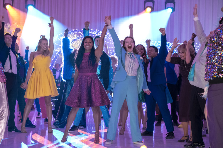 """Nico Greetham as Nick, Logan Riley Hassel as Kaylee, Ariana Debose as Alyssa Greene, Andrew Rannells as Trent Oliver, Jo Ellen Pellman as Emma, Sofia Deler as Shelby, Nathaniel Potvin as Kevin, Tracey Ullman as Vera and James Corden as Barry Glickman in """"The Prom"""" on Netflix."""