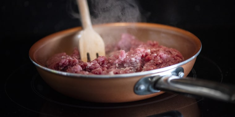 Cooking mince beef in a pan.