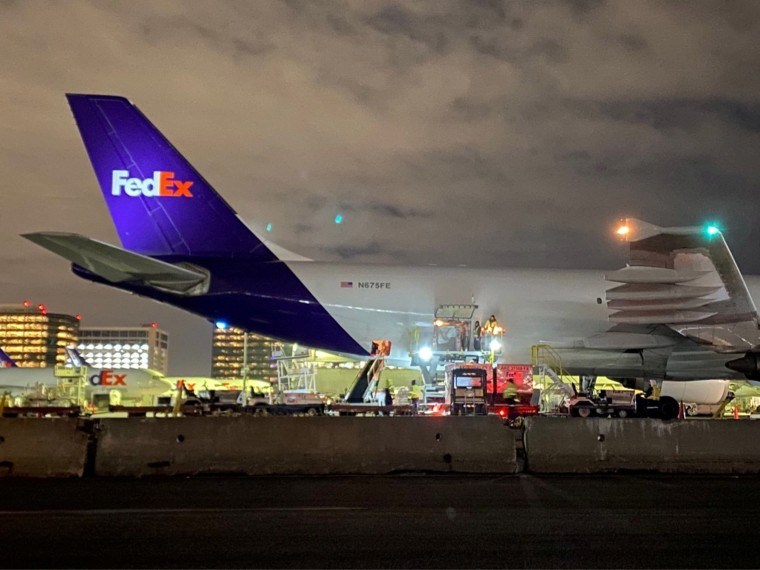 Image: A plane of FedEx Express carrying a first batch of Pfizer/BioNTEch COVID-19 vaccine at LAX Airport, Los Angeles