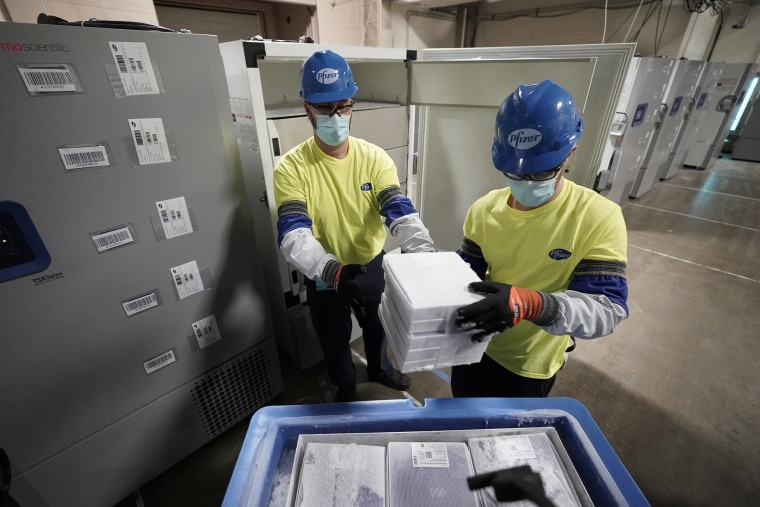 Image: Boxes containing the Pfizer-BioNTech COVID-19 vaccine are prepared to be shipped at the Pfizer Global Supply Kalamazoo manufacturing plant in Portage, Mich.