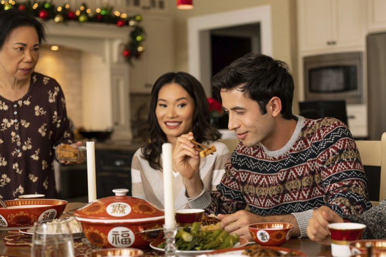 """Lillian Lim, Jacky Lai, center, and Tony Giroux in a scene from Lifetime's """"A Sugar & Spice Holiday."""""""