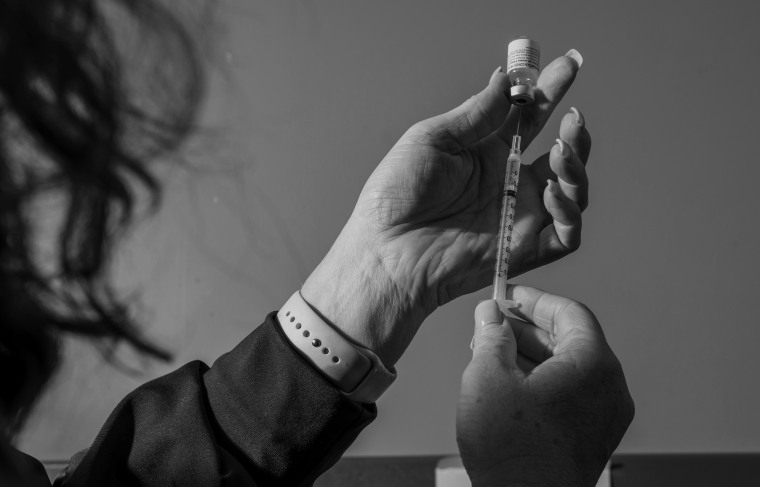 Image: A nurse prepares a Pfizer-BioNTech Covid-19 vaccine in Manning, S.C., on Dec. 17, 2020.
