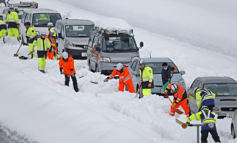 Image: Vehicles are stranded on the snow-covered Kanetsu expressway in Niigata Prefecture on Friday.