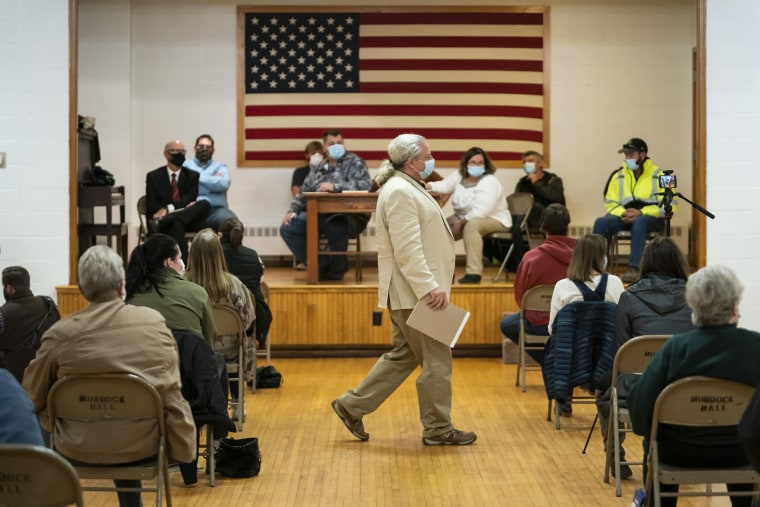 Lawyer and member of the Asatru Folk Assembly Allen Turnage returns to his seat, Wednesday, Oct. 14, 2020, in Murdock, Minn., after taking questions from the public.