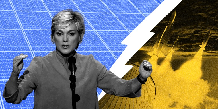 Image: Jennifer Granholm speaks in front of a divided background, one half has solar panels and the other has nuclear missiles.