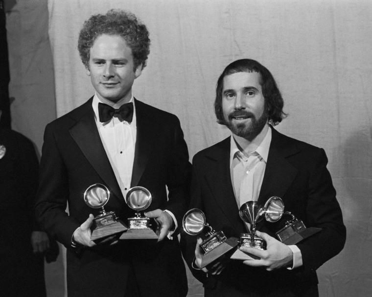 Simon And Garfunkel Holding Grammy Award