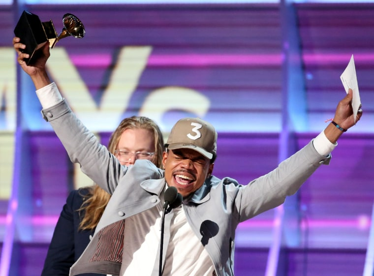 "Image: Chance the Rapper celebrates as he accepts the Grammy for Best Rap Album for ""Coloring Book"" at the 59th Annual Grammy Awards in Los Angeles"