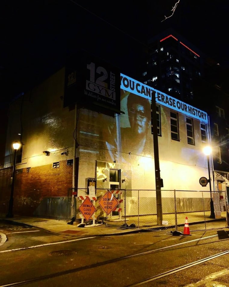 """Ortiz projected an image of Casarez on the newly painted wall, along with a message: """"You can't erase our history."""""""