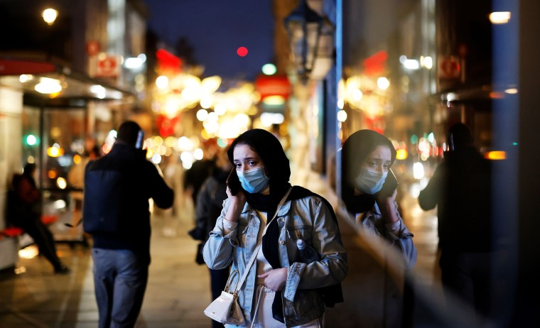 Image: Pedestrians walk past shops on Piccadilly on Dec. 19, 2020, in London.