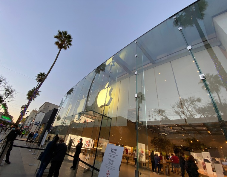 Image: Holiday lights and decorations are seen at the Apple Store on Third Street Promenade on Dec. 18, 2020 in Santa Monica, Calif.
