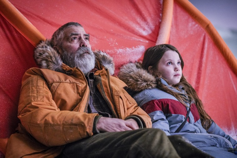 """Caoilinn Springall as Iris and George Clooney as Augustine in a scene from """"The Midnight Sky."""""""