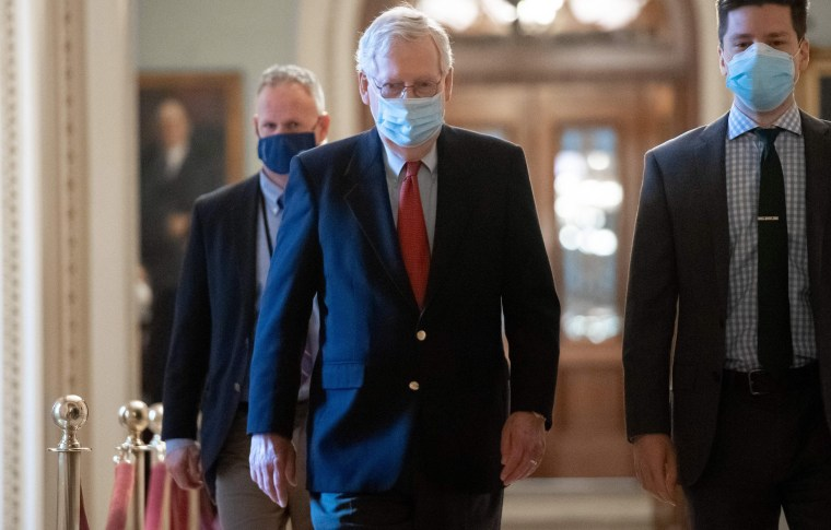 Image: Senate Majority Leader Mitch McConnell walks to his office from the Senate Floor at the U.S. Capitol,