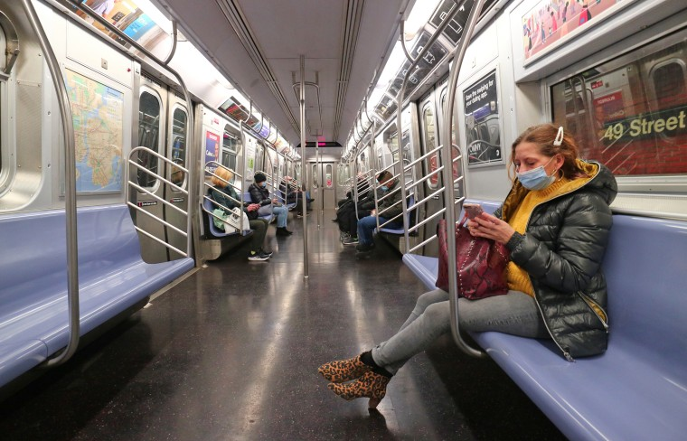 Passengers on a subway train in New York on on Nov. 16, 2020.